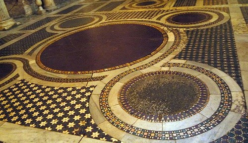 Cosmatesque Quincunx at S. Maria in Cosmedin. The central roundel was often made of porphyry to symbolize Christ's royalty. See Paloma's book Cosmatesque Ornament for more.