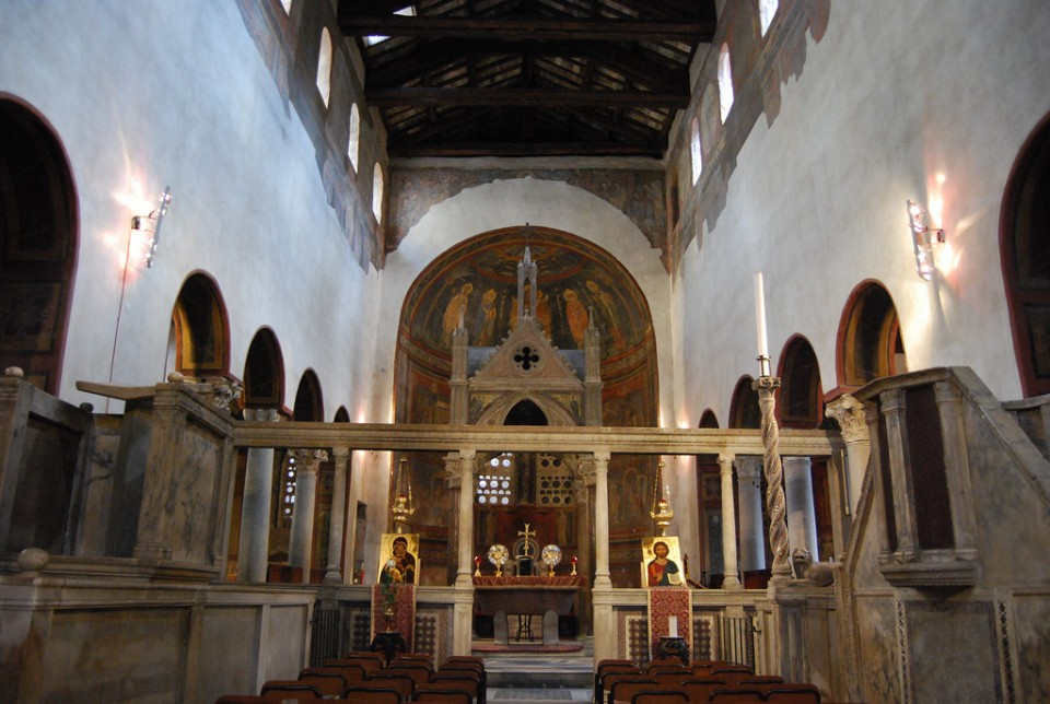 A view from the choir looking toward the sanctuary at Santa Maria in Cosmedin, Rome. Columns and entablature atop the low wall, or templon, mark the boundary of the sanctuary. In antiquity, curtains hung between the columns