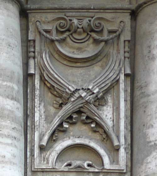 Palms of victory, symbol of martyrdom, under a Roman shield, set in another lively frame.