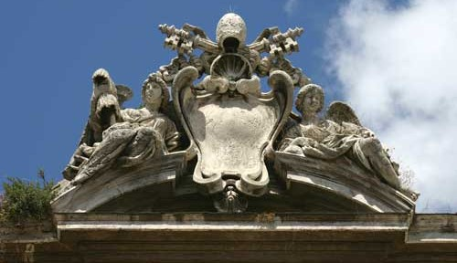 The Papal coat of arms, flanked by angels.