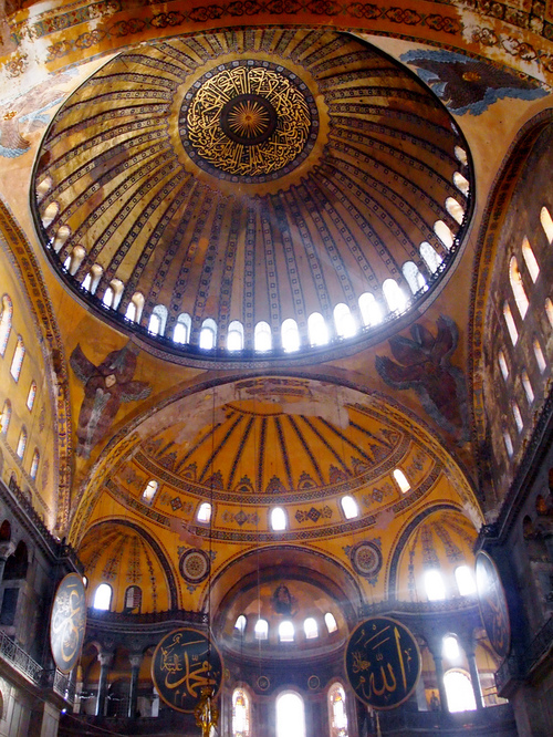 The pendentives of the Hagia Sophia are decorated with Seraphim, the highest of the choirs of angels, with six wings and many eyes (Revelation 4:8). They support the dome of Heaven. [Image source]