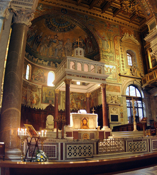 The confessio below the high altar at Santa Maria in Trastevere makes it impossible to say Mass from the assembly's side of the altar.